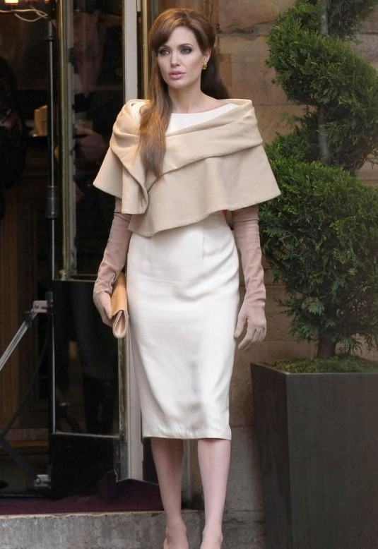 b760d5837f11 Cape is one of the must have items for this season. Here (picture above) a  beige short cape is combined with a dress